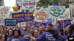 FILE - Members of 1199 Service Employees International Union march up Fifth Avenue in the annual Labor Day Parade in New York in 2015. (AP Photo/Bryan R. Smith)