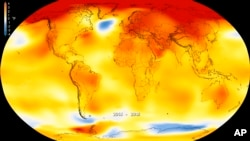 This map made available by NASA in February 2019 shows global surface temperature anomalies for 2014-2018. Higher than normal temperatures are shown in red and lower than normal temperatures are shown in blue. (Kathryn Mersmann/NASA - Scientific Visualiza
