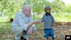 Chip Lyons with child in Kenya.