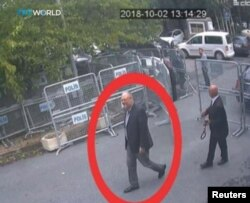 FILE - A still image taken from CCTV video and obtained by TRT World claims to show Saudi journalist Jamal Khashoggi, highlighted in a red circle by the source, as he arrives at Saudi Arabia's Consulate in Istanbul, Turkey, Oct. 2, 2018.