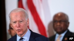 Democratic presidential candidate former Vice President Joe Biden, speaks as he is endorsed by House Majority Whip, Rep. Jim Clyburn, D-S.C., background, in North Charleston, S.C., Feb. 26, 2020.