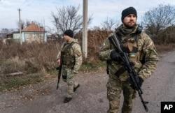 Ukrainian policemen patrol a street near the new line of contact in Katerynivka, Luhansk region, eastern Ukraine, Nov. 2, 2019.
