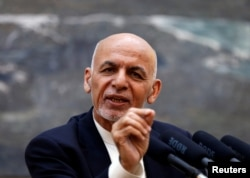 FILE - Afghan President Ashraf Ghani speaks during a news conference in Kabul.
