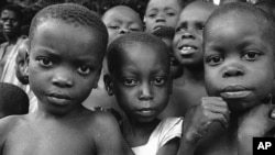 FILE - A group of starving Biafran children wait at Aba for doctors to see them, July 27, 1968.