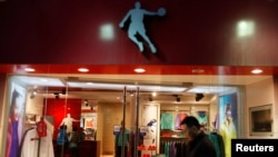 A man walks past a Qiaodan sports store in downtown Shanghai in 2012. Michael Jordan sued Qiaodan, accusing the company of using his name without permission. (REUTERS/Aly Song)