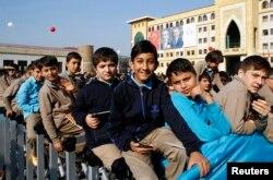 FILE - Students of Tevfik Ileri Imam Hatip School wait for the arrival of President Tayyip Erdogan for the opening ceremony in Ankara.