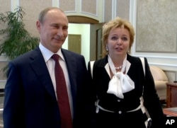 """FILE - In this grab made from video provided by the Russia24 TV Channel on June 6, 2013, Russian President Vladimir Putin, left, and his wife, Lyudmila, speak to journalists after attending the ballet """"La Esmeralda"""" in the Kremlin Palace in Moscow, Russia. Putin and his wife announced on state television that they were divorcing."""