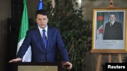 FILE - Italian Premier Matteo Renzi addresses the media during a joint press conference with his Algerian counterpart, Abdelmalek Sellal, in Algiers, Algeria, Dec. 2, 2014.