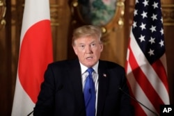President Donald Trump speaks during a joint news conference with Japanese Prime Minister Shinzo Abe at the Akasaka Palace, Nov. 6, 2017, in Tokyo.