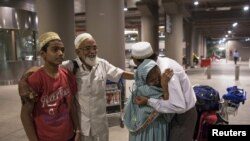 An Indian evacuee from Yemen hugs her son after arriving at the international airport in Mumbai, April 6, 2015.