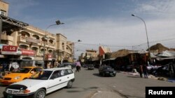 FILE - Vehicles drive past in a street in Mosul, 390 km (240 miles) north of Baghdad, March 12, 2012. Islamic State militants occupied the city in mid-2014.