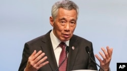 In this Nov. 15, 2018, file photo, Singaporean Prime Minister Lee Hsien Loong speaks during a press conference following the 33rd ASEAN summit in Singapore.