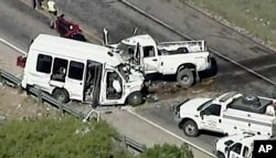Authorities respond to a deadly crash involving a van carrying church members and a pickup on a highway in the U.S. state of Texas, March 29, 2017.
