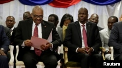 Haiti's Prime Minister Jack Guy Lafontant (L) checks documents beside President Jovenel Moise during Lafontant's inauguration ceremony at the National Palace in Port-au-Prince, Haiti, March 21, 2017. REUTERS/Andres Martinez