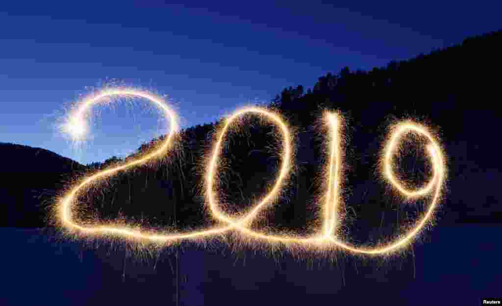 "The numbers ""2019"" are written in the air with a sparkler near a tourist camp outside Krasnoyarsk, Russia, Dec. 31, 2018."