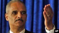U.S. Attorney General Eric Holder speaks during a news conference in Hong Kong, 19 Oct. 2010