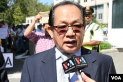 FILE: Kuch Schanly, a Cambodian American analyst in Maryland, talked to VOA Khmer during a protesters where about 200 Cambodian Americans demand respect of human rights and democracy and the release of Kem Sokha, CNRP president, in front of State Department, Washington DC, on September 15, 2017. (Say Mony/VOA Khmer)