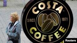 FILE - A woman walks past a Costa Coffee in Loughborough, Britain, April 25, 2018.