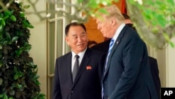 FILE - President Donald Trump talks with Kim Yong Chol, left, former North Korean military intelligence chief and one of leader Kim Jong Un's closest aides, as they walk from the Oval Office at the White House in Washington, June 1, 2018.