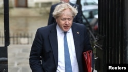 Britain's Foreign Minister Boris Johnson arrives in Downing Street for a meeting of the government's special COBRA committee in London, March 7, 2018.