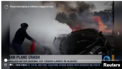 Máy bay vận tải quân sự Iran bị cháy hôm 14/1/2019. Photo chụp từ Reuters