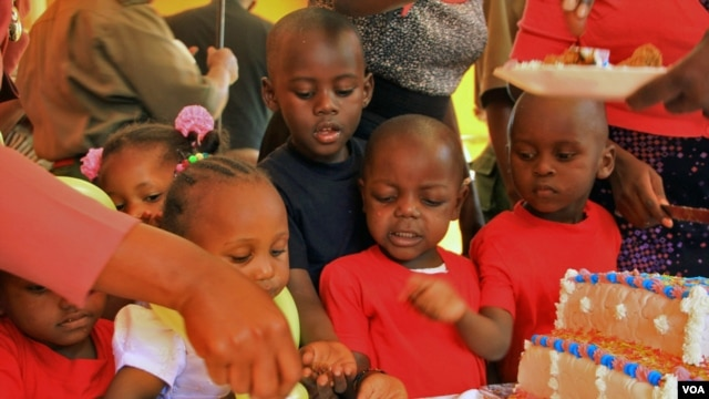 Children of female prisoners celebrate the opening of a new day care facility at the Langata Women's Prison in Nairobi, Jan. 23, 2013.
