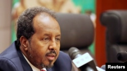 Somalia's President Hassan Sheikh Mohamud addresses a news conference at the African Union Headquarters in Addis Ababa on May 26, 2013.