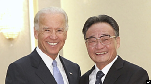 US Vice President Joseph Biden, left, shakes hands with Chinese National Peoples Congress Standing Committee Chairman Wu Bangguo during their meeting at the Great Hall of People in Beijing, China, August 18, 2011