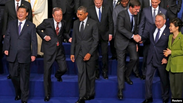 China's President Xi Jinping, U.N. Secretary-General Ban Ki-moon, U.S. President Barack Obama, Netherlands' P.M. Mark Rutte, Kazakhstan's President Nursultan Nazarbayev and South Korea's President Park Geun-hye (L-R) take part in a photo with other world leaders at the Nuclear Security Summit in The Hague, March 25, 2014.