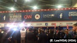 Reporters, campaign workers and candidates jockey for position in the 'spin room' following the undercard event at the Dec. 15 GOP presidential debate in Las Vegas.