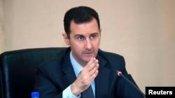 Syria's President Bashar al-Assad in seen in February 12, 2013, file photo