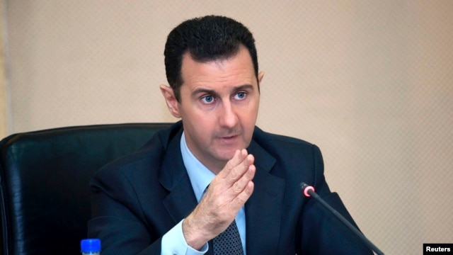 Syria's President Bashar al-Assad in seen in February 12, 2013, file photo