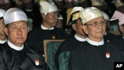 Burma President Thein Sein, right, and Vice President Thiha Thura Tin Aung Myint Oo are pictured in this February 2011 file photo. Burma's junta was officially disbanded after handing over power to a new so-called civilian government, March 30, 2011