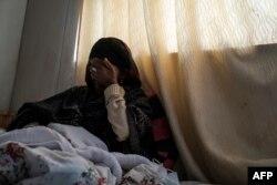 Berhan (siyo jina lake halisi )miaka 30, asili yake Edaga Hamus, akiwa hospitali Mekele, on Februari 27, 2021. - inadaiwa alibakwa na kundi la wanajeshi wa Eritrea and Ethiopia katika matukio matatu tofauti.