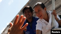A supporter waves at presidential candidate Grace Poe during election campaigning in General Mariano Alvarez, Cavite in the Philippines May 3, 2016.