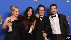 "Patricia Arquette, from left, Lorelei Linklater, Ellar Coltrane, and Ethan Hawke pose in the press room with the award for best motion picture - drama for ""Boyhood"" at the 72nd annual Golden Globe Awards at the Beverly Hilton Hotel on Sunday, Jan. 11, 201"