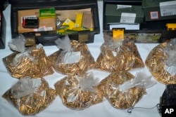 This undated photo provided by the Santa Clara County Sheriff's Office shows approximately 22,000 rounds of ammunitions found at the residence of Samuel Cassidy.