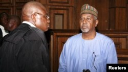 Charged with illegal possession of weapons and acts that pose potential harm to national security, gormer National Security Adviser Sambo Dasuki, right, arrives at the Federal High Court in Abuja, Nigeria, Sept. 1, 2015.