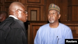Former National Security Adviser Sambo Dasuki (R) arrives with one of his counsels Ahmed Raji at the Federal High Court in Abuja, Nigeria, Sept. 1, 2015.