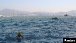 Hong Kong Swimmers Brave Busy Waters