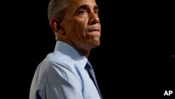 Presiden AS Barack Obama memberikan sambutan di Macomb Community College (9/9) di Warren, Michigan. (AP/Andrew Harnik)