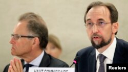 Newly appointed U.N. High Commissioner for Human Rights, Jordan's Prince Zeid Raad al-Hussein, right, speaks at the Human Rights Council. With him is Michael Moeller, the U.N. acting director-general, in Geneva, Sept. 8, 2014.