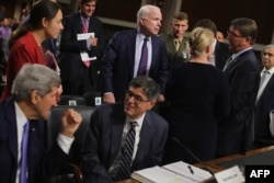 Senate Armed Services Committee Chairman John McCain, center, talks with, from left, Secretary of State John Kerry, Treasury Secretary Jacob Lew, Senator Kirsten Gillibrand, Defense Secretary Ashton Carter and Energy Secretary Ernest Moniz on Capitol Hill