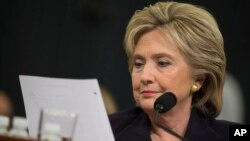 FILE - Democratic presidential candidate, former Secretary of State Hillary Rodham Clinton looks at an email sent by Ambassador Chris Stevens during her testimony before the House Benghazi Committee.
