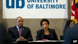 U.S. Attorney General Loretta Lynch, right, speaks with members of Congress and faith leaders at the University of Baltimore, in Maryland, May 5, 2015.