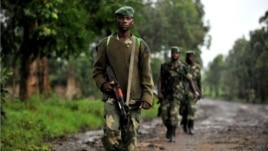 M23 rebel group soldiers patrol in Rangira, near Rutshuru, DRC, October 17, 2012.
