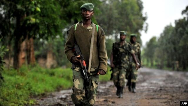 M23 rebel group soldiers patrol in Rangira, near Rutshuru, DRC, October 17, 2012.