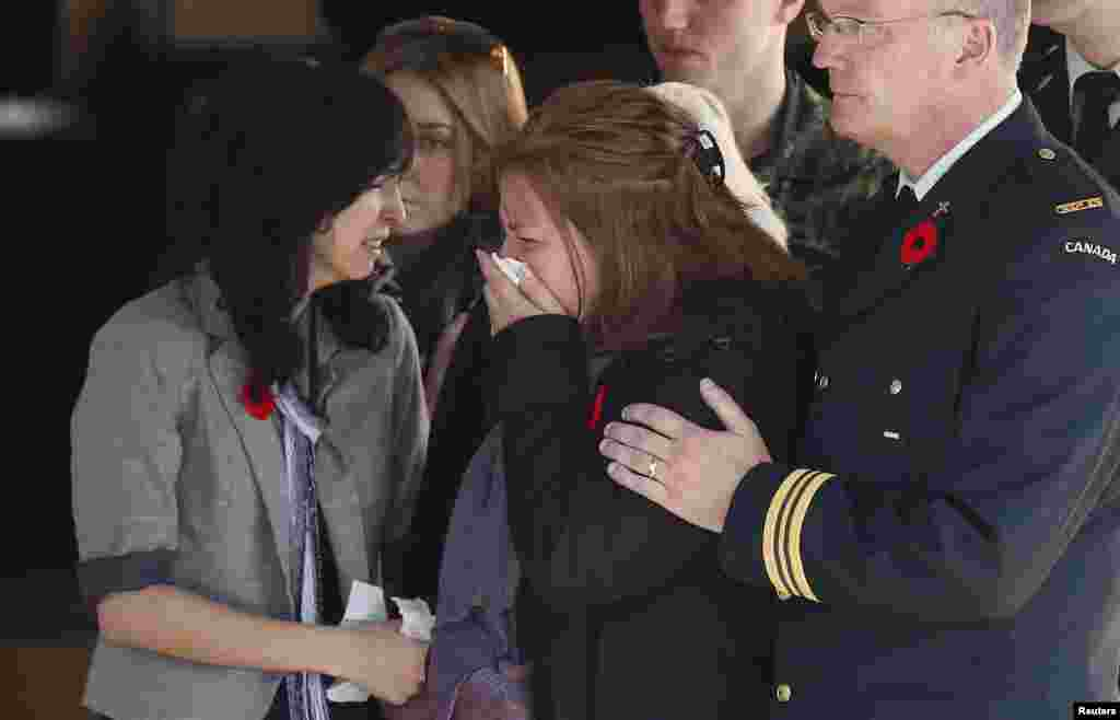 Kathy Cirillo, the mother of Cpl. Nathan Cirillo, the serviceman who was killed when a gunman attacked multiple locations in downtown Ottawa, reacts as his casket is placed in a hearse at a funeral home in Ottawa, Canada, Oct. 24, 2014.