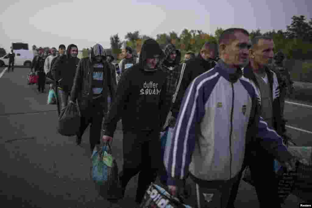 Pro-Russian POWs wait to be exchanged, north of Donetsk, eastern Ukraine, Sept. 28, 2014.
