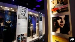 Gowns and outfits of Grammy winning performers are framed by pylons decorated with the covers of albums of the year winners during each decade at the Grammy Museum Mississippi in Cleveland, Mar. 2, 2016. This is the second and only official Grammy Museum outside of Los Angeles, California.